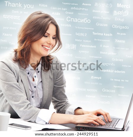 Business woman or teacher in office. Different world languages concept. - stock photo