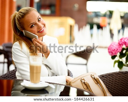 Business woman outside on a break