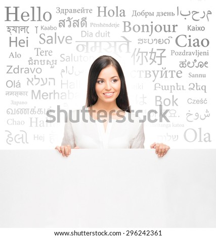 Business woman over the background with a different world languages (foreign language school) - stock photo