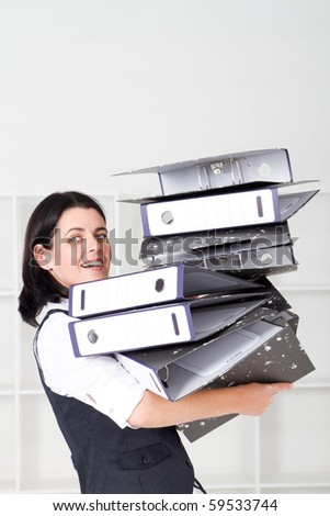 Business woman overloaded with a lot of  files - stock photo