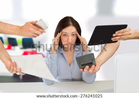 business woman overwhelmed with so much work - stock photo