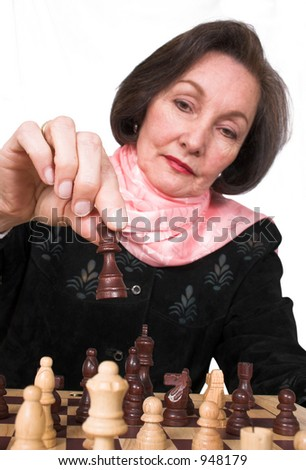 business woman playing chess over a white background - stock photo