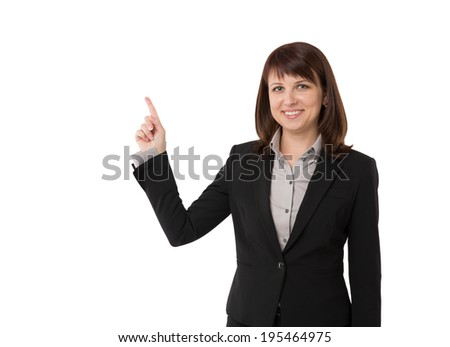 Business woman pointing at copyspace, isolated on white - stock photo