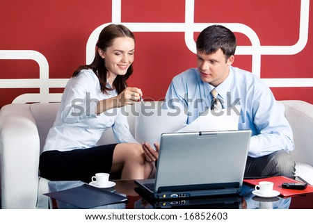 Business woman pointing at document and speaking with her boss - stock photo