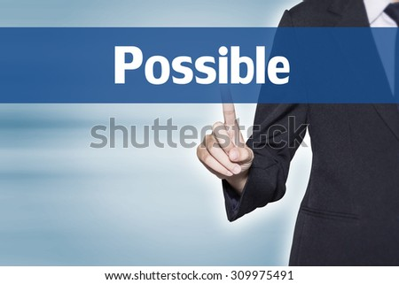 Business woman pointing at Possible word for business background concept - stock photo