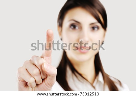 business woman pointing at something on screen - stock photo