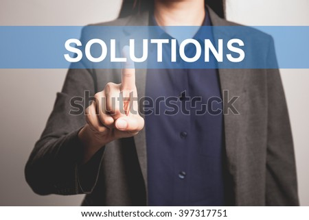 Business woman pointing at word of Solutions