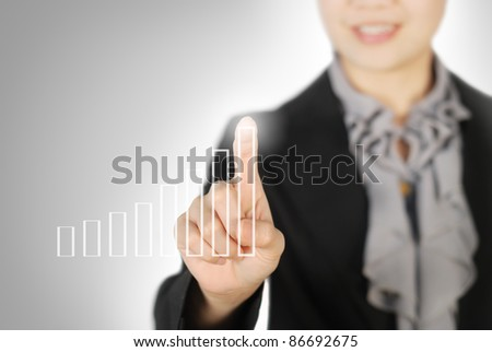 Business woman pointing graph on screen