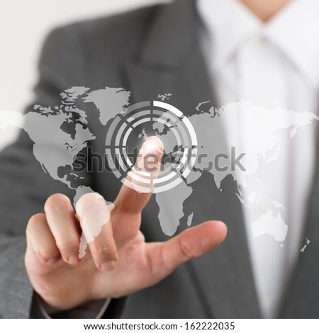 Business woman pointing her finger on virtual button on world map - stock photo