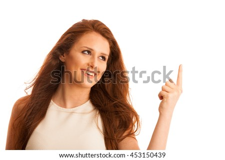 Business woman pointing to copy space while presenting a product in commercial - having new idea isolated over white