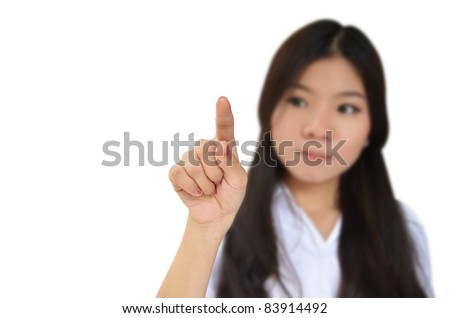 Business woman pointing to something isolated on white background - stock photo