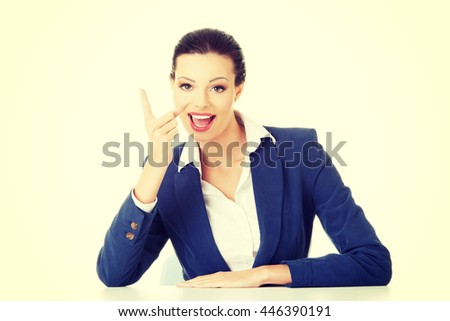 Business woman pointing with finger to empty copy space - stock photo