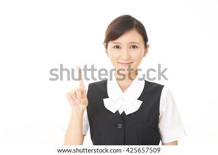 Business woman pointing with her finger - stock photo