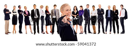 business woman pointing with her team behind her - stock photo