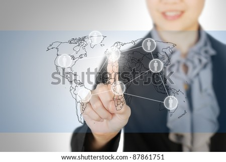 Business woman pointing world map screen - stock photo