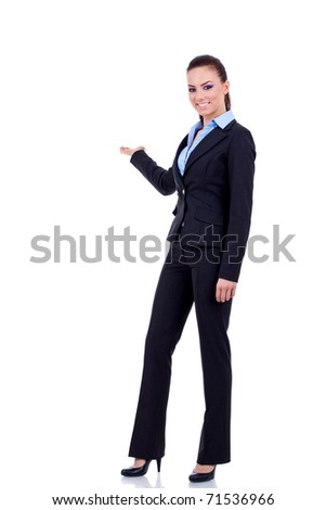 Business woman points  at something in her back. Isolated on white background - stock photo