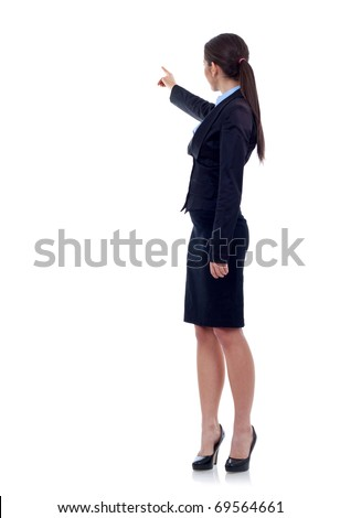 Business woman points finger at something in her back. Isolated on white background - stock photo