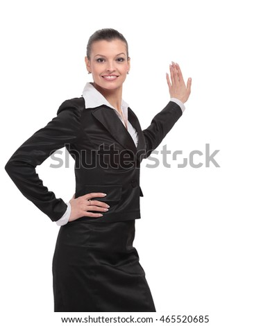 Business woman points to advertise on the wall