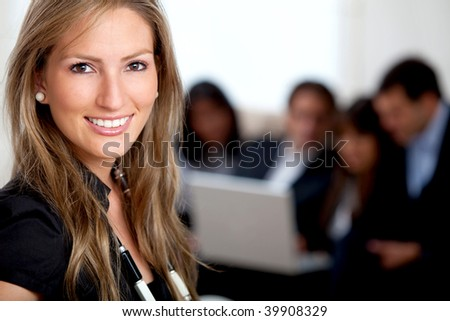 Business woman portrait at the office smiling