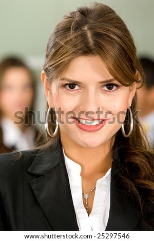 business woman portrait in an office smiling