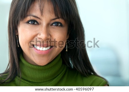 business woman portrait in an office smiling - stock photo