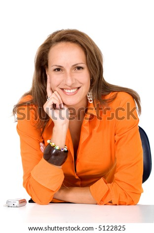 business woman portrait in orange on her office desk - stock photo