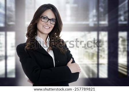 BUSINESS WOMAN PORTRAIT on city background - stock photo