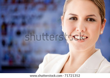Business woman portrait smiling at the office - stock photo