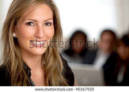 Business woman portrait smiling in an office