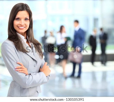 Business woman portrait smiling in an officeq - stock photo