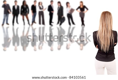 Business woman posing backwards with group of people in the back