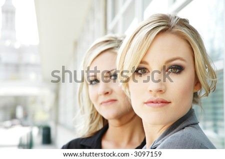 business woman posing in a business setting in front of business buildings - stock photo