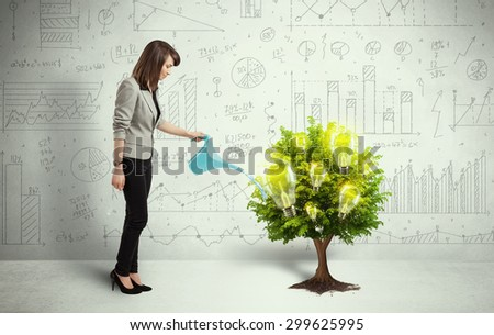 Business woman pouring water on lightbulb growing tree concept - stock photo