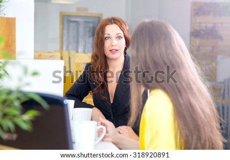 Business woman present at the meeting in the office. She interviews or talking about himself. Interview. Business meeting. Negotiations. The visit to the client. View towards the interlocutor. Marvel. - stock photo