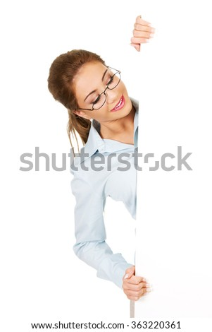 Business woman presenting your product. - stock photo