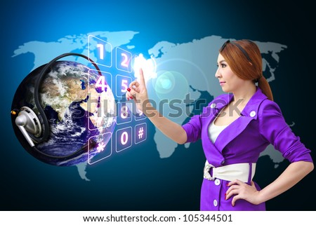 Business woman press on dial pad number on digital world : Elements of this image furnished by NASA - stock photo