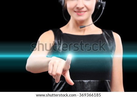 business woman presses a button on the touch screen.  - stock photo
