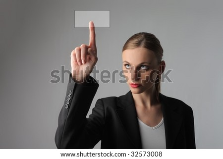 business woman pressing a digital button - stock photo
