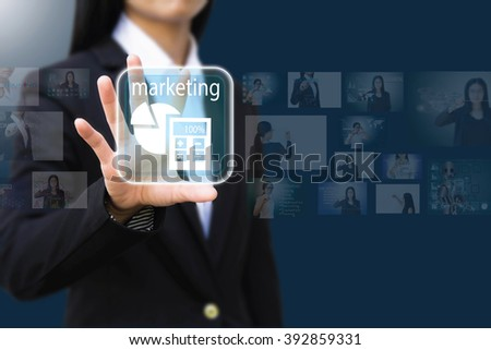 business woman pressing a marketing  concept button