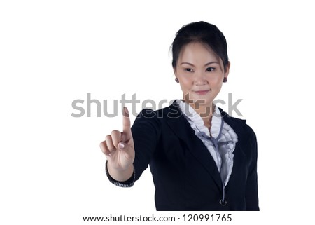 Business woman pressing button or something. Isolated on white background with copy space for your design. Focus at finger. Model is Asian woman. - stock photo