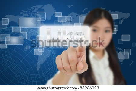 Business woman pressing like button on technology screen - stock photo