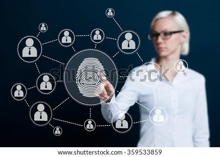 Business woman pressing modern technology web panel with fingerprint print - stock photo