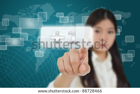Business woman pressing plus button on technology screen - stock photo