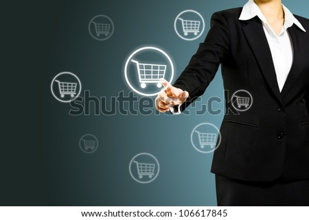 Business woman pressing shopping cart icon - stock photo