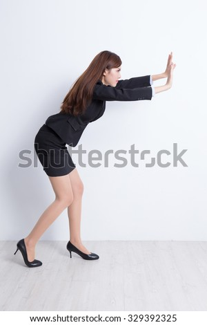 business woman push something with white wall background, great for your design or text, asian