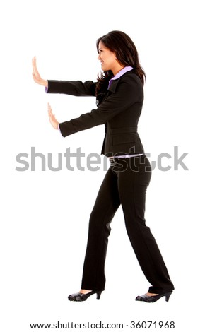 Business woman pushing something imaginary isolated over white