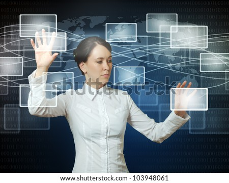 business woman pushing virtual icons in web interface with her hands over blue - stock photo