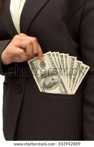 Business woman putting dollar bills U.S. banknotes into her pocket on white background. - stock photo