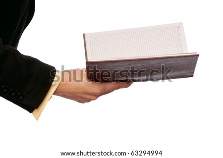 business woman reads book to get ideas for business plan - stock photo