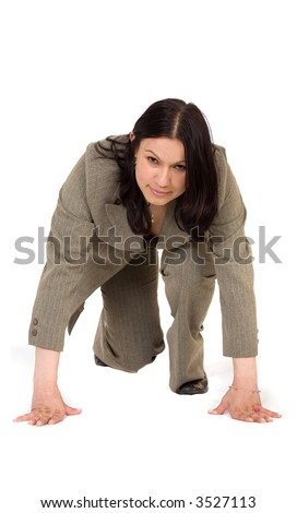 Business woman ready to race - isolated over a white background - stock photo